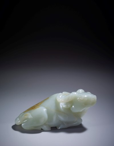 A CARVED WHITE JADE RECUMBENT