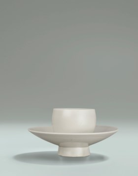 A DING INTEGRAL CUP AND CUP STAND