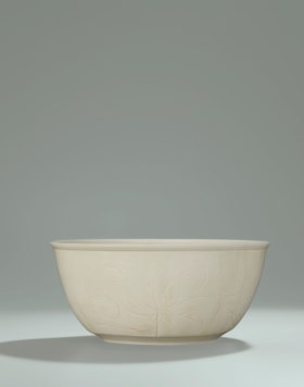 A VERY RARE AND SUPERBLY CARVED LARGE DING BOWL