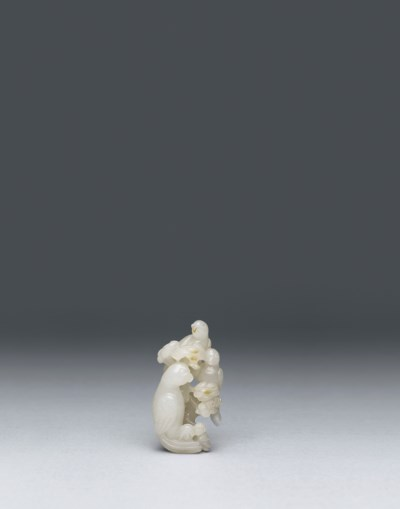 A WHITE JADE CARVING OF THREE