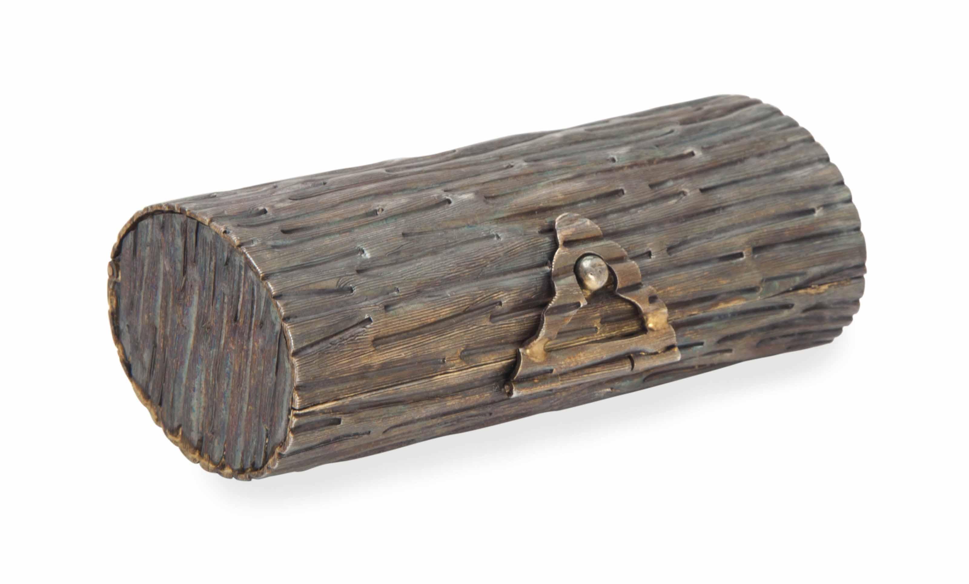 A MEXICAN SILVER GILT LOG-FORM TROMPE-L'OEIL CIGARETTE CASE,