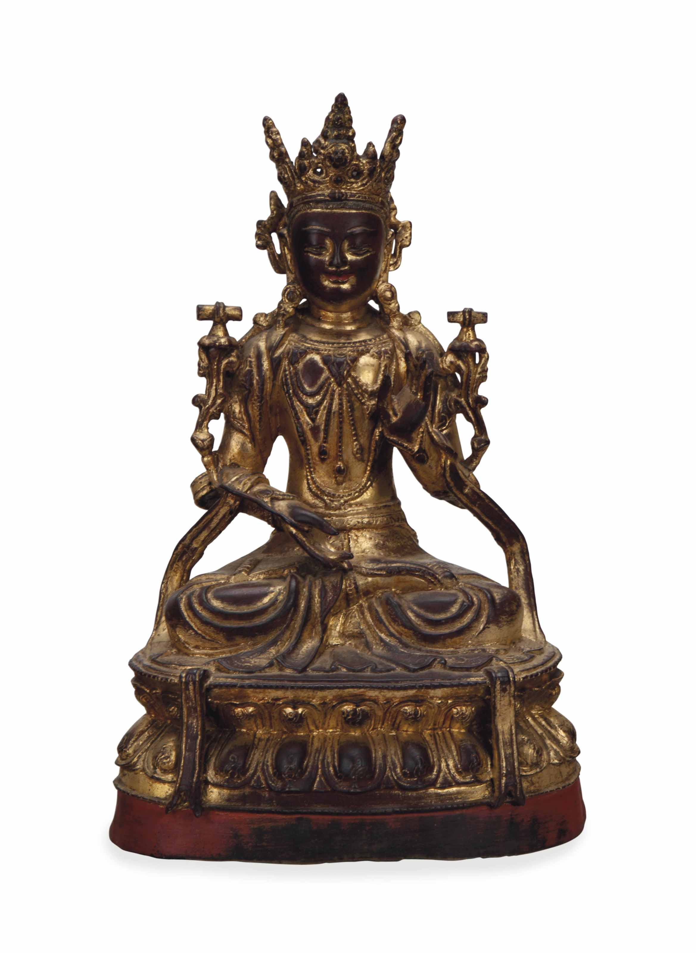 A CHINESE GILT LACQUERED BRONZ