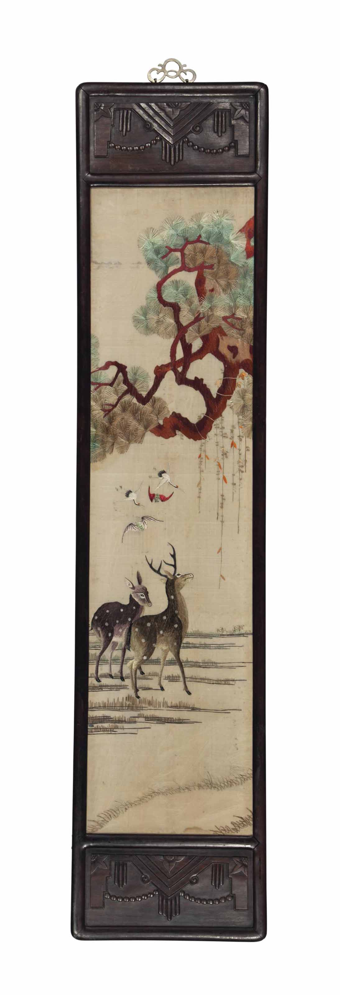 AN ASIAN SILK AND EMBROIDERY FRAGMENT,