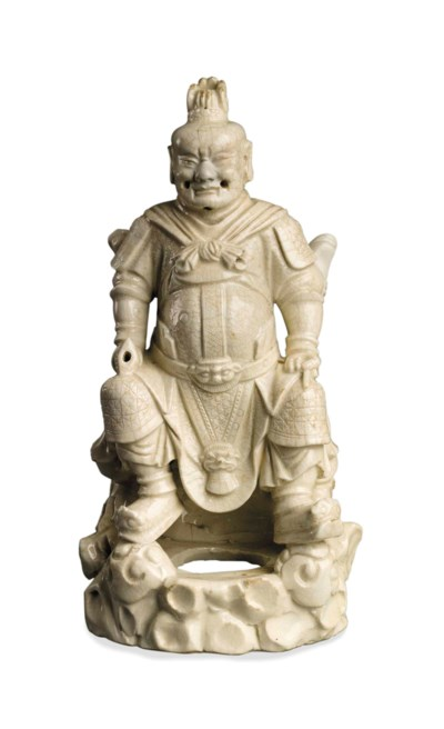 A CHINESE DEHUA FIGURE OF A WA