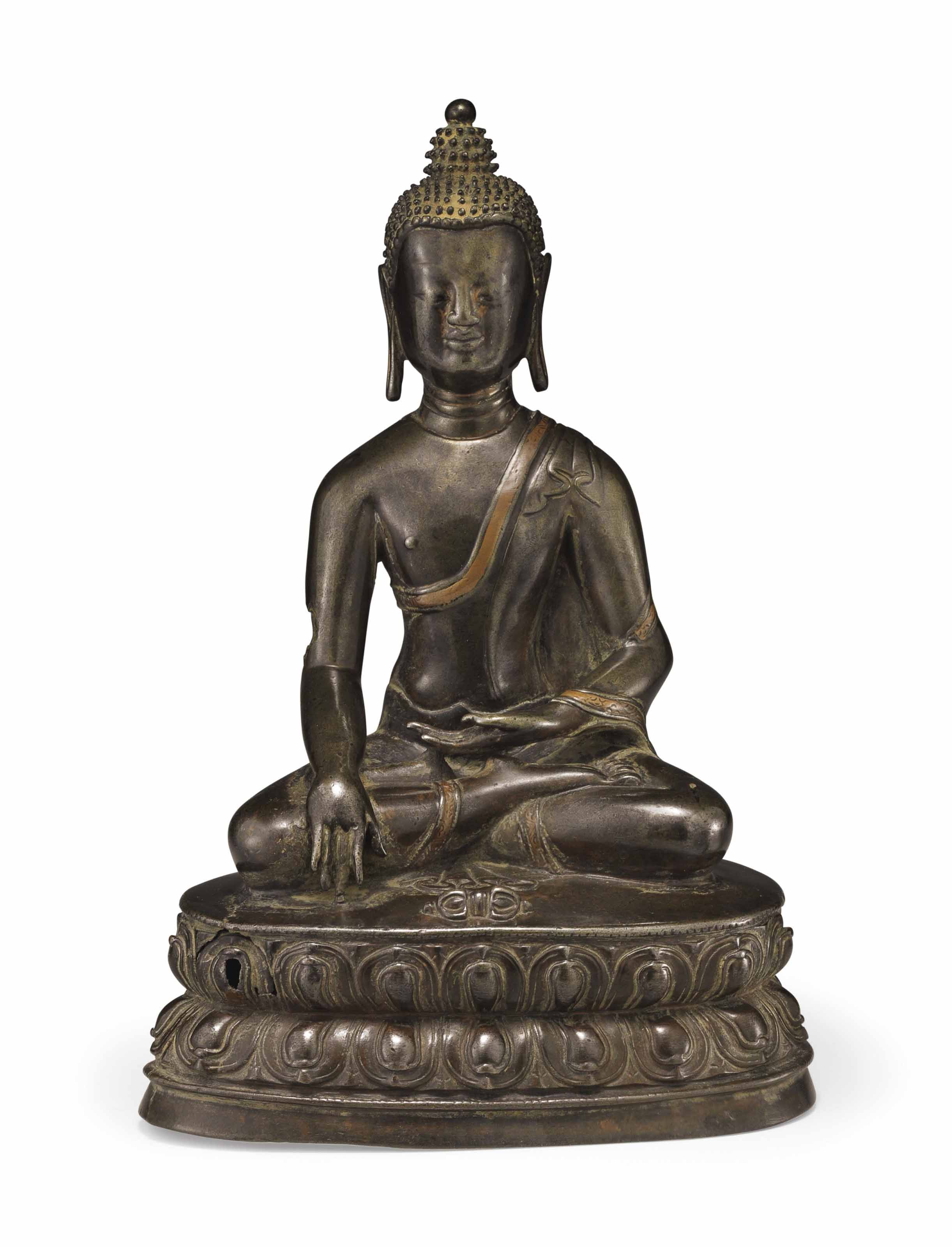 A TIBETAN COPPER-INLAID BRONZE
