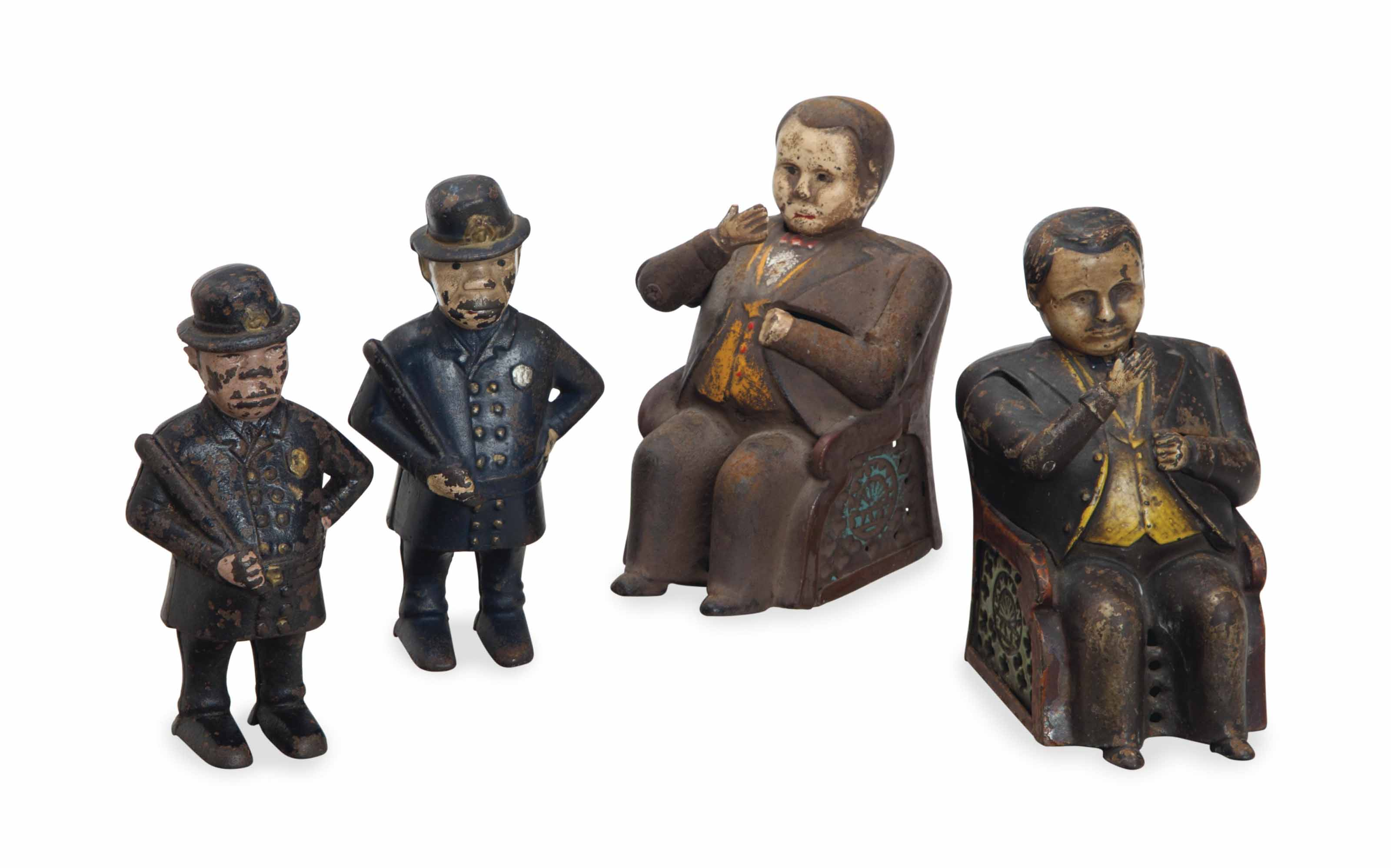 A GROUP OF FOUR CAST IRON AND POLYCHROME-PAINTED FIGURAL BANKS,