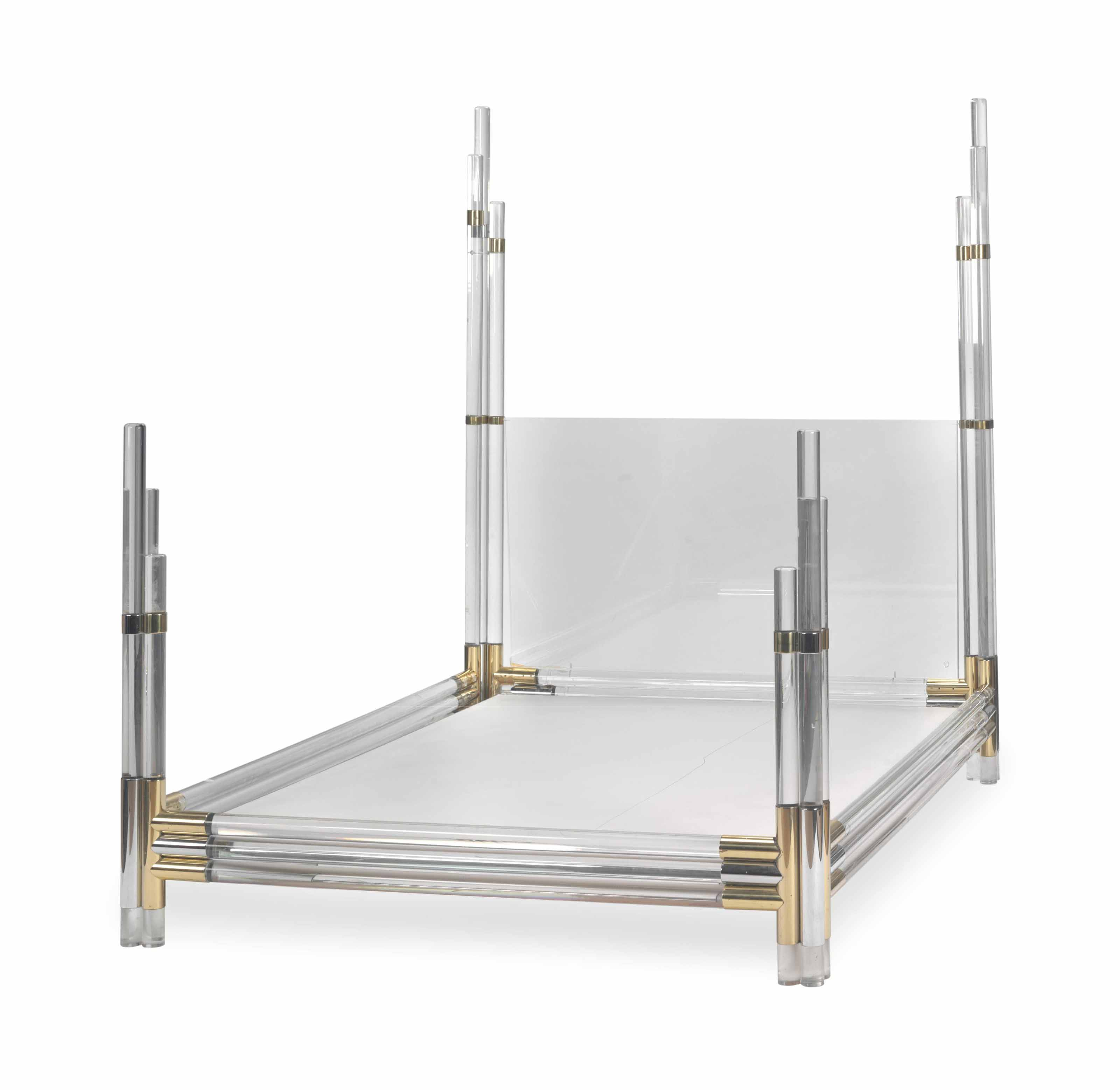 A LUCITE, CHROME AND BRASS FOUR POSTER BED,