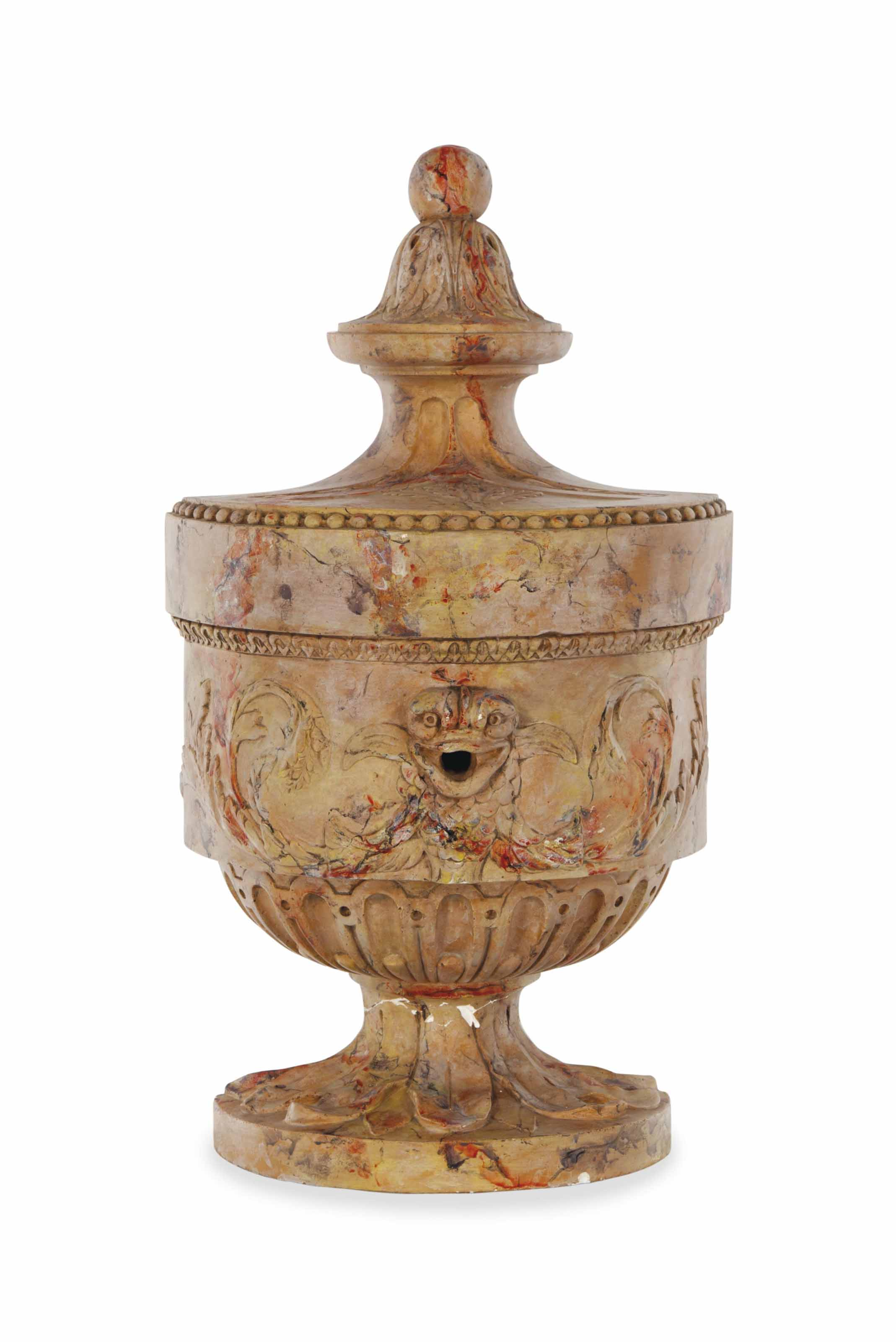 A FAUX MARBLE-DECORATED PLASTER WATER FONT,