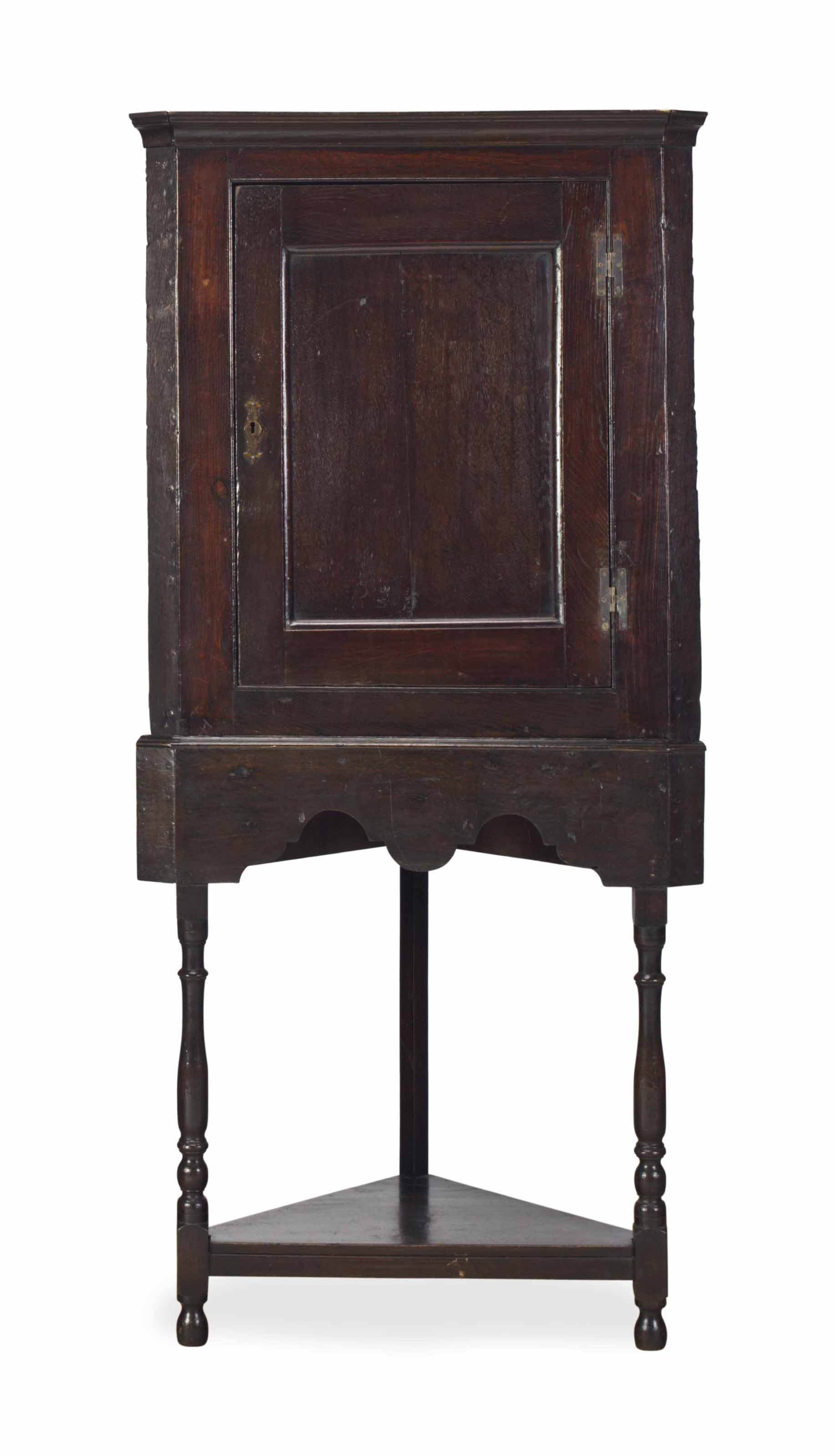 AN ENGLISH OAK CORNER CABINET,