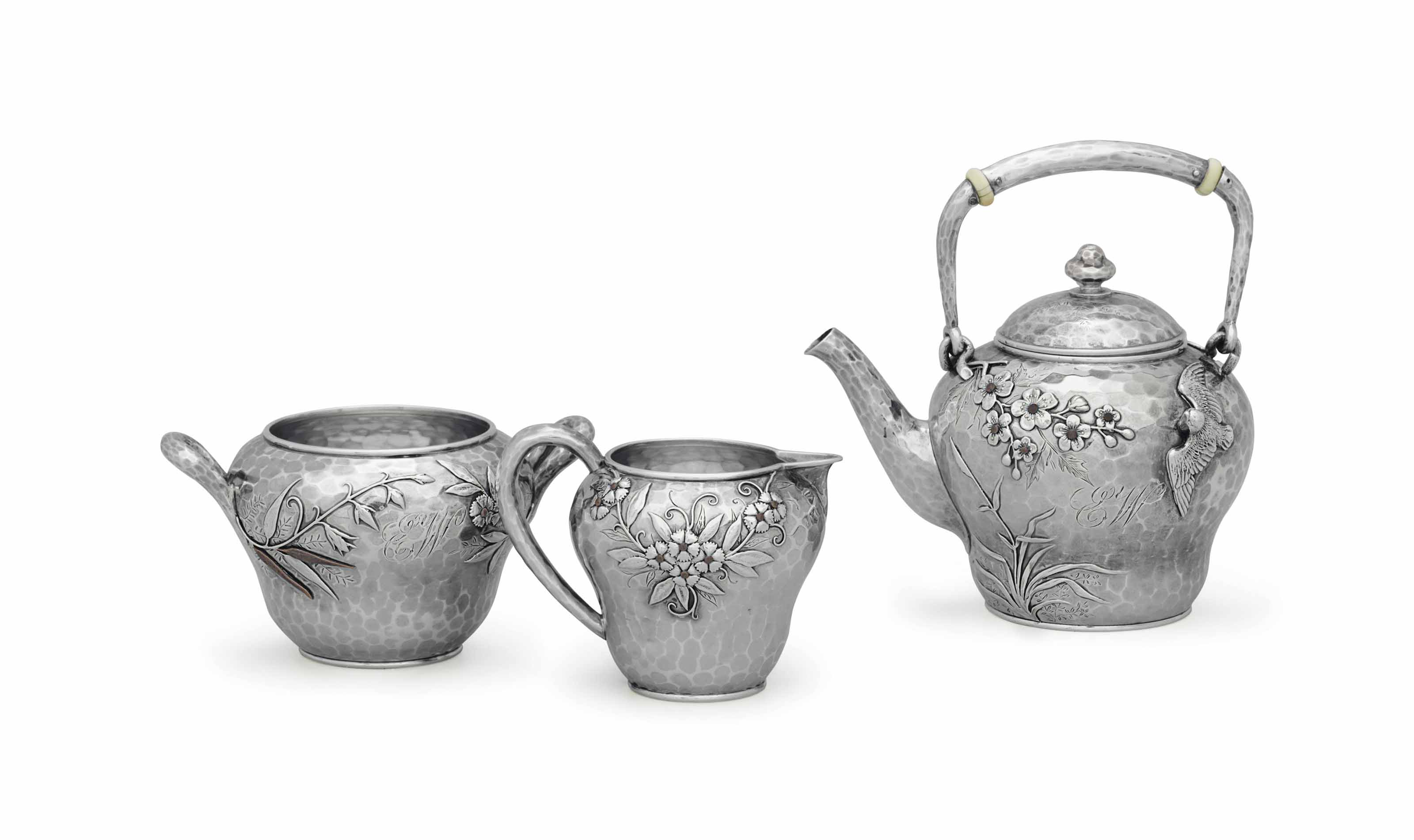 A SILVER AND MIXED-METAL THREE-PIECE TEA SERVICE**