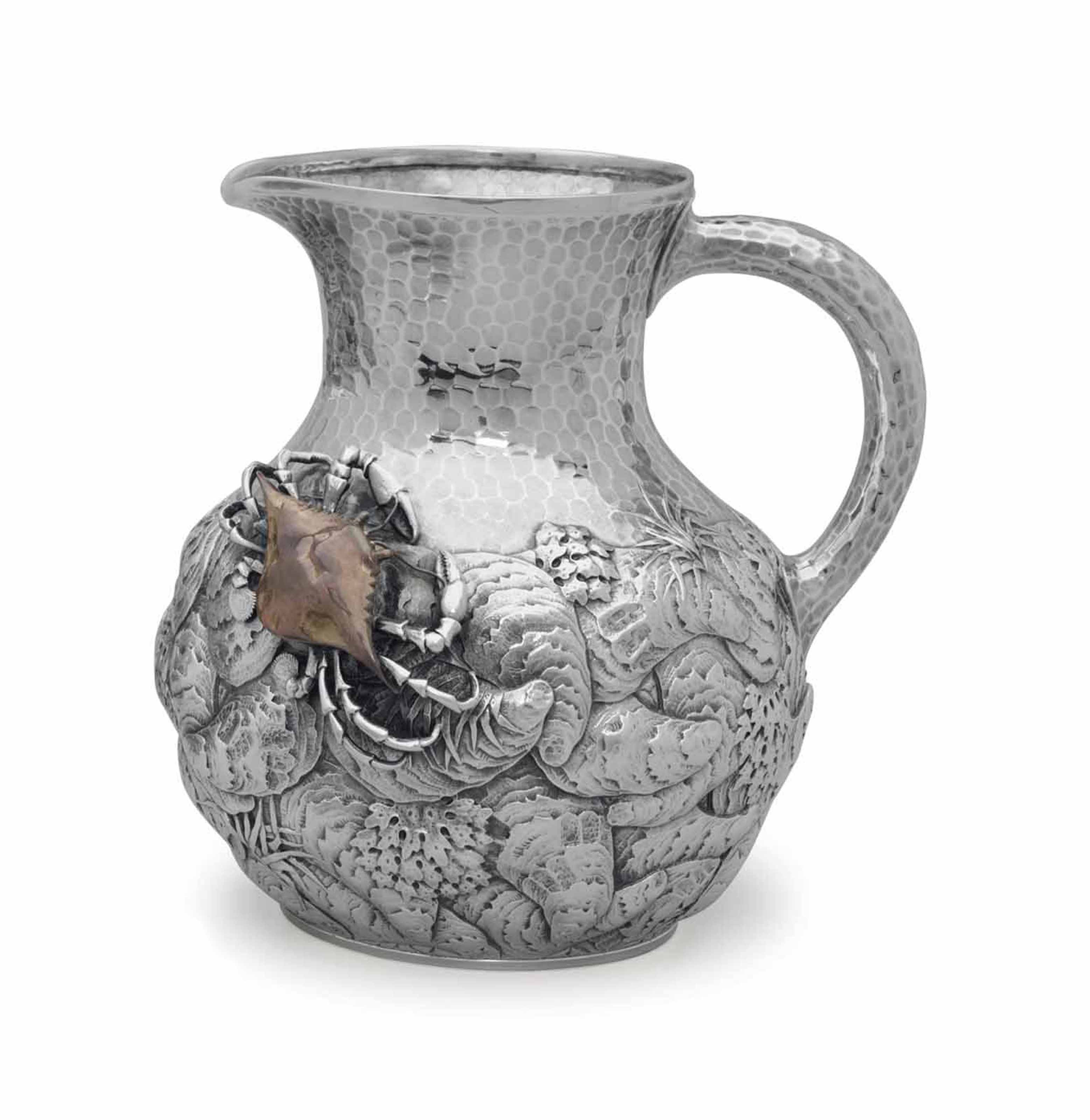 A SILVER AND MIXED-METAL PITCHER