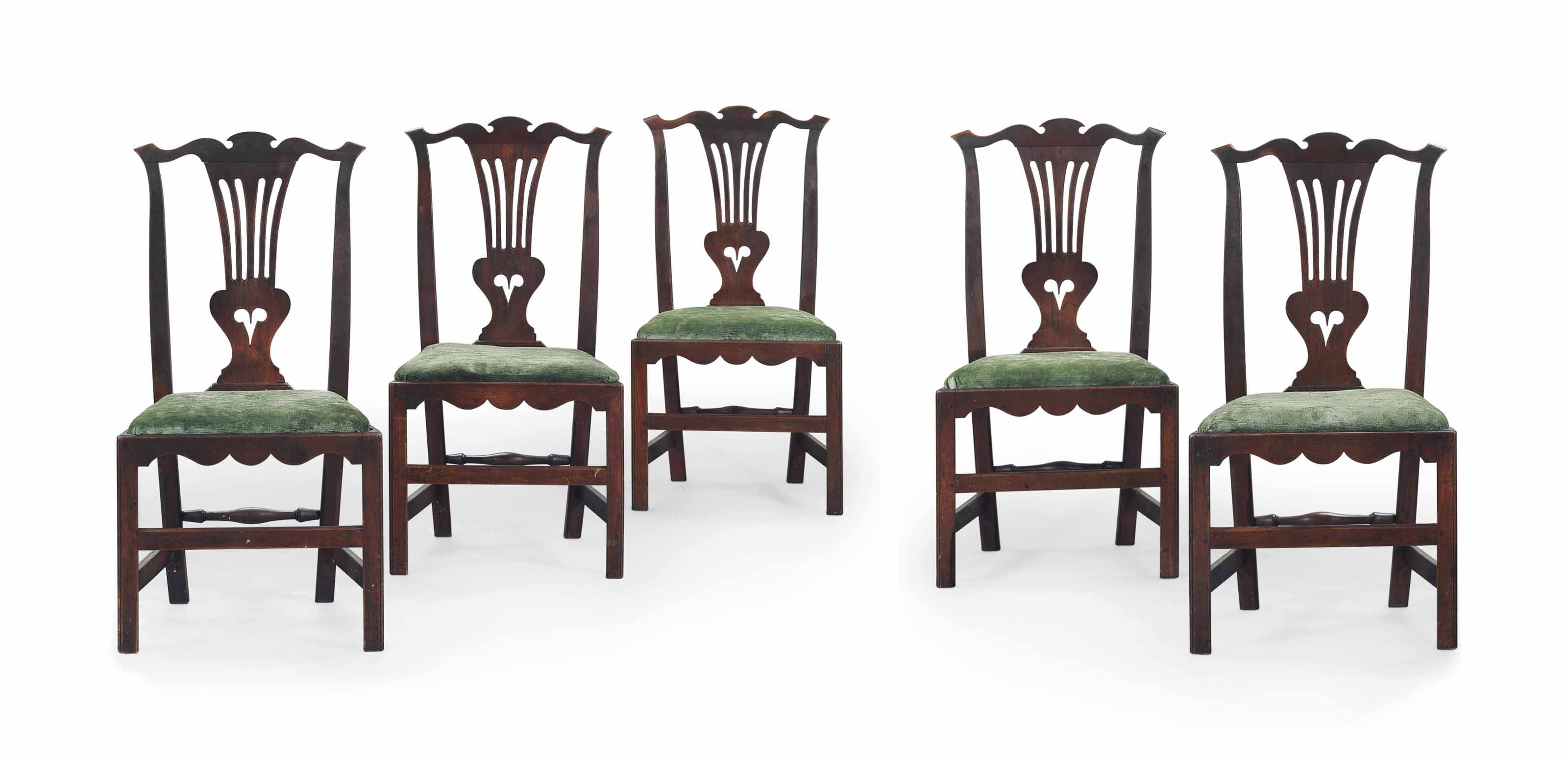 A SET OF FIVE CHIPPENDALE WALNUT DINING CHAIRS