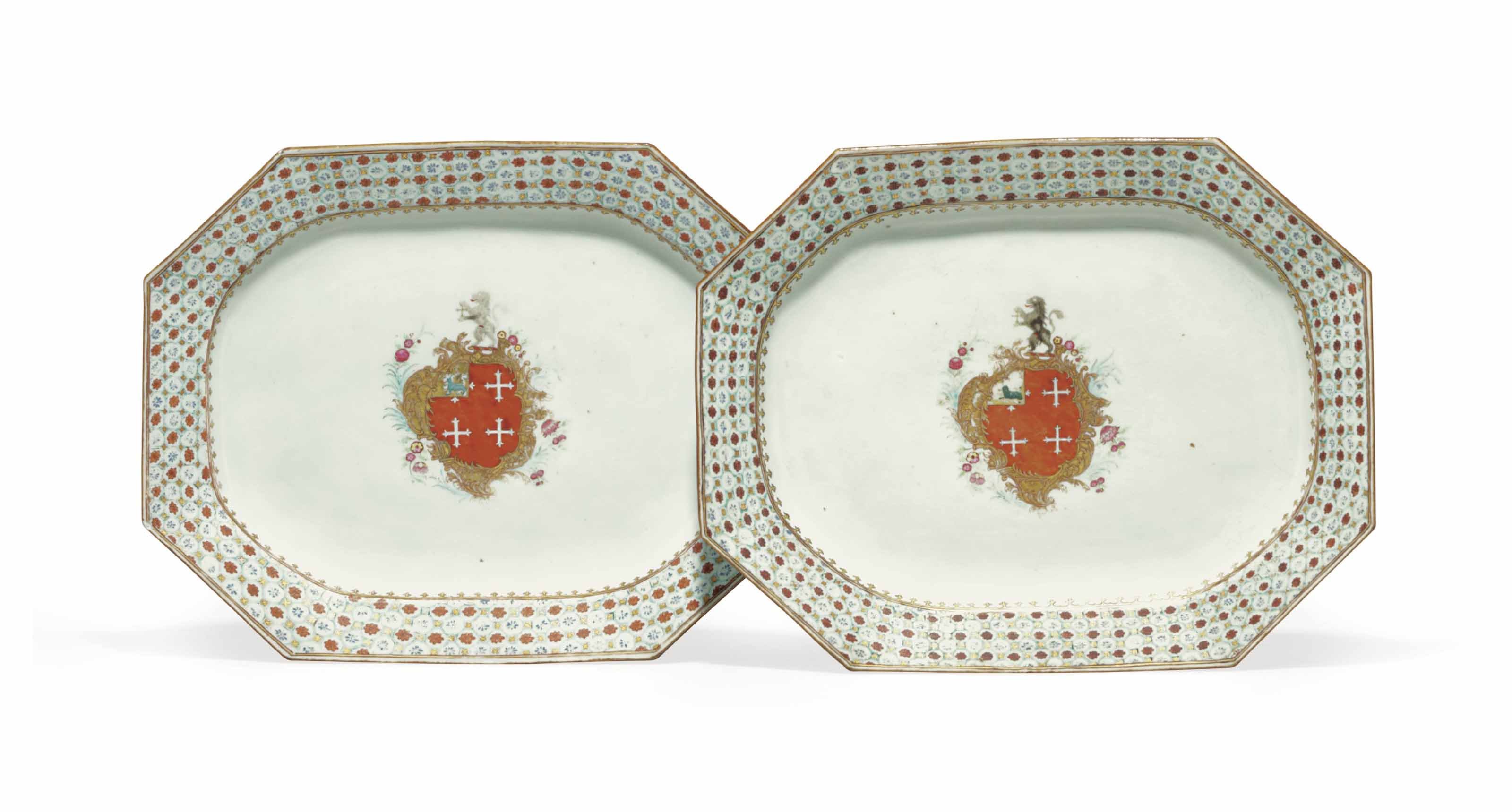 A PAIR OF CHINESE EXPORT ARMORIAL OCTAGONAL PLATTERS AND SALTS