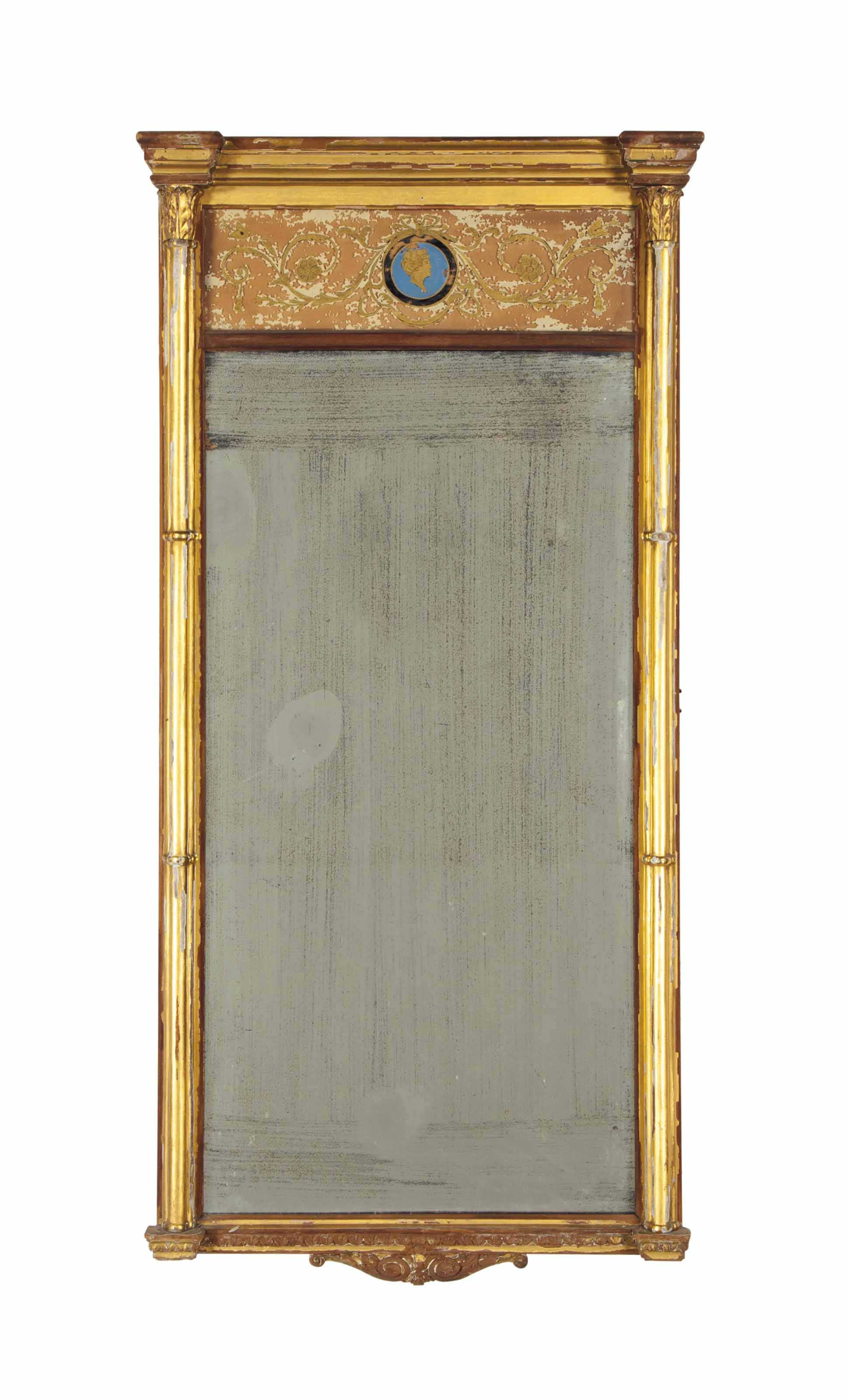 AN AMERICAN GILTWOOD AND EGLOMISE LOOKING GLASS,