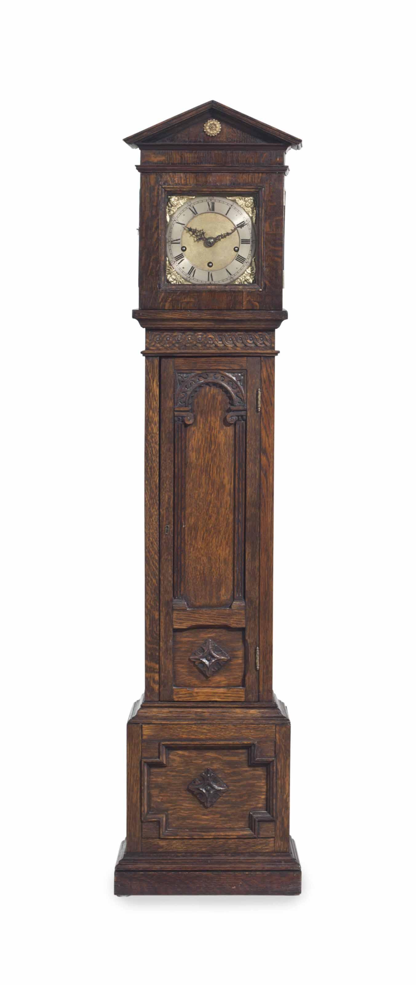 AN ENGLISH OAK GRANDMOTHER CLOCK,