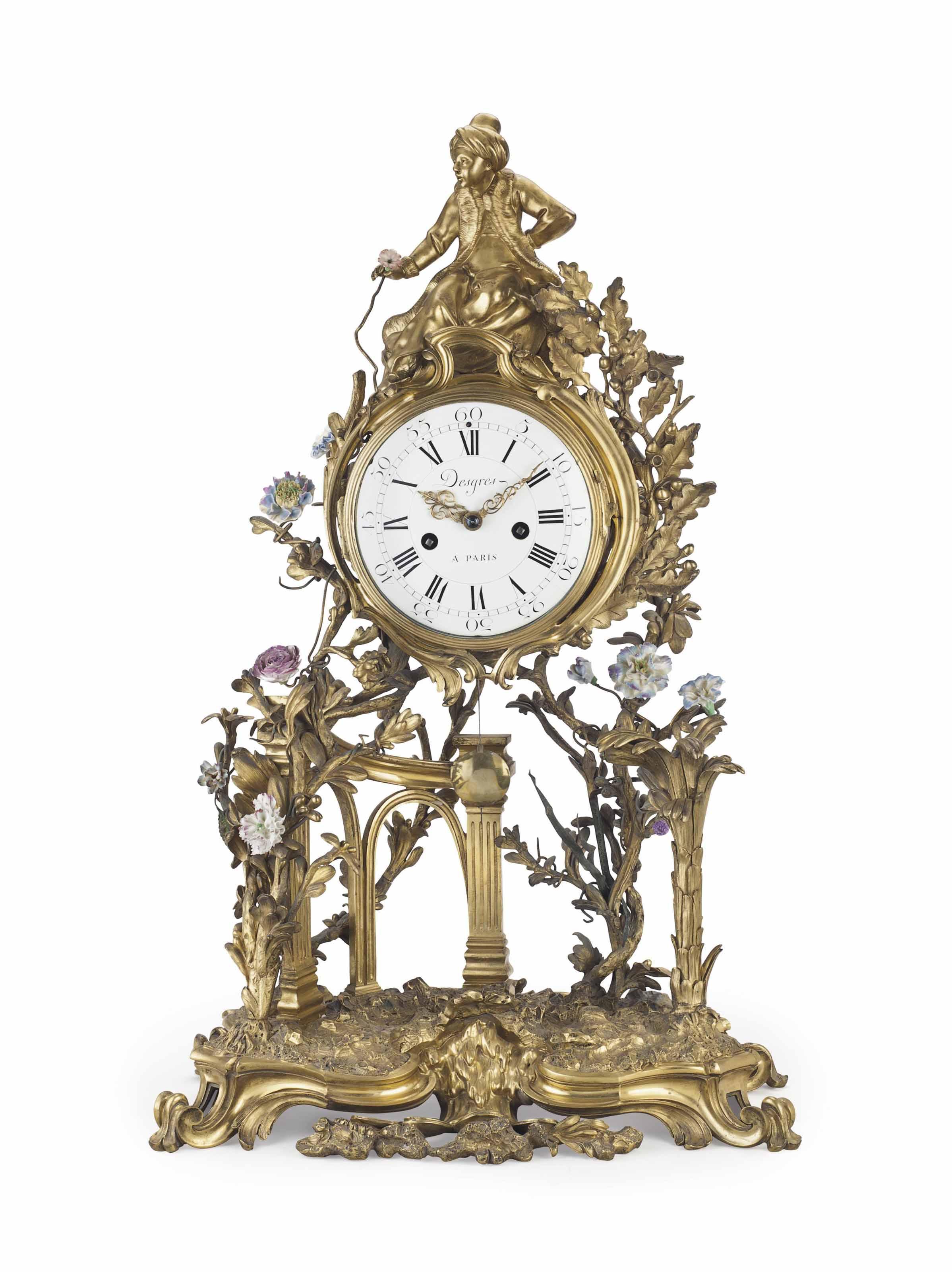 A FRENCH ORMOLU AND PORCELAIN MANTEL CLOCK,