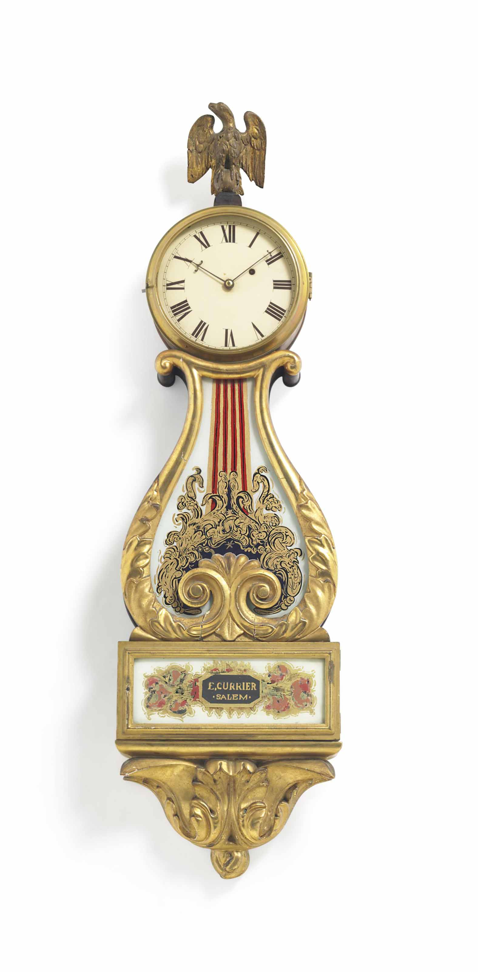A CLASSICAL PARCEL-GILT MAHOGANY AND EGLOMISE LYRE TIMEPIECE CLOCK,