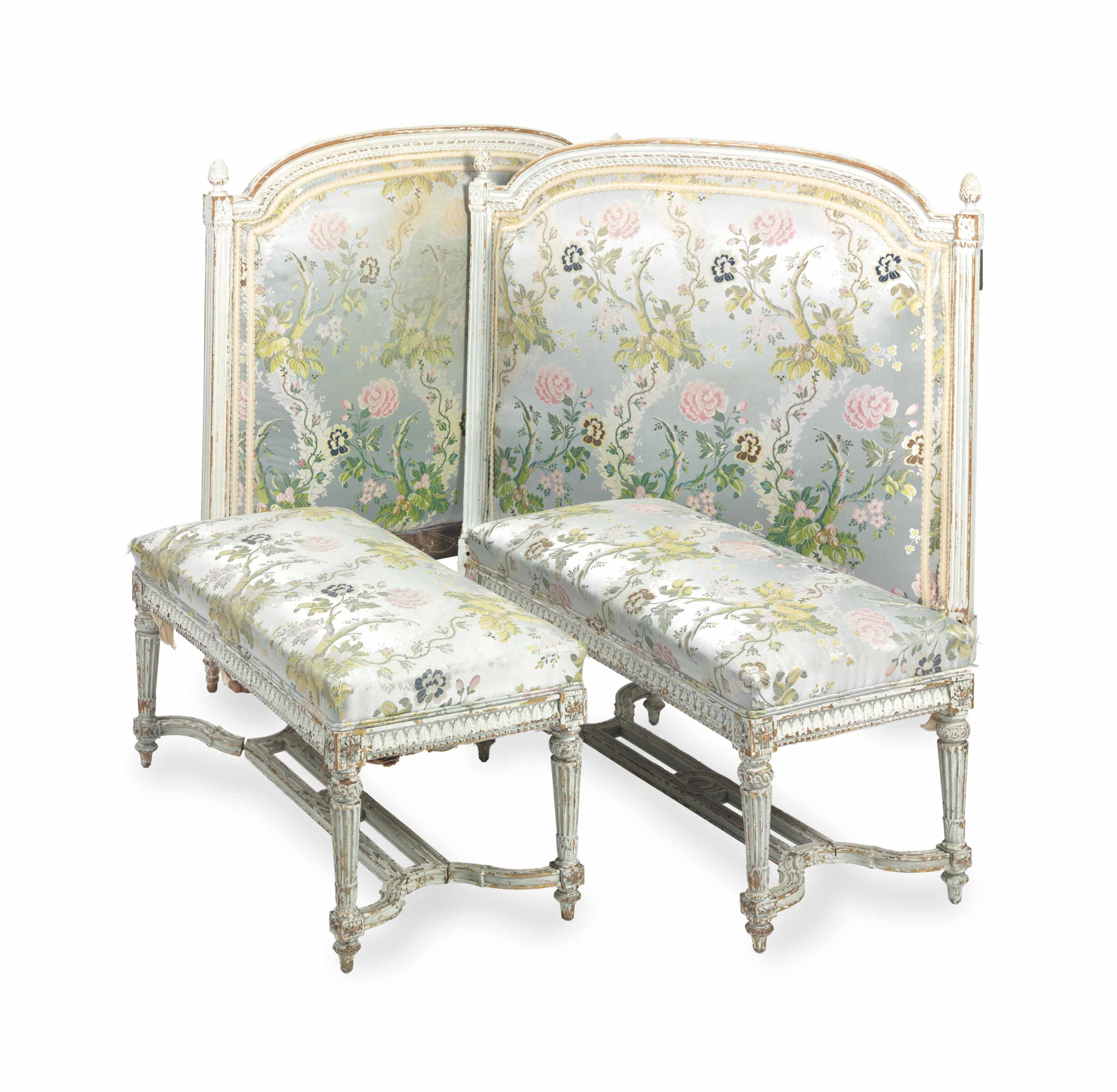 A PAIR OF LOUIS XVI STYLE BLUE-PAINTED BENCHES AND A PAIR OF HEADBOARDS COVERED IN BLUE SILK,