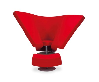 A 'SOFT EASY CHAIR' AND OTTOMA
