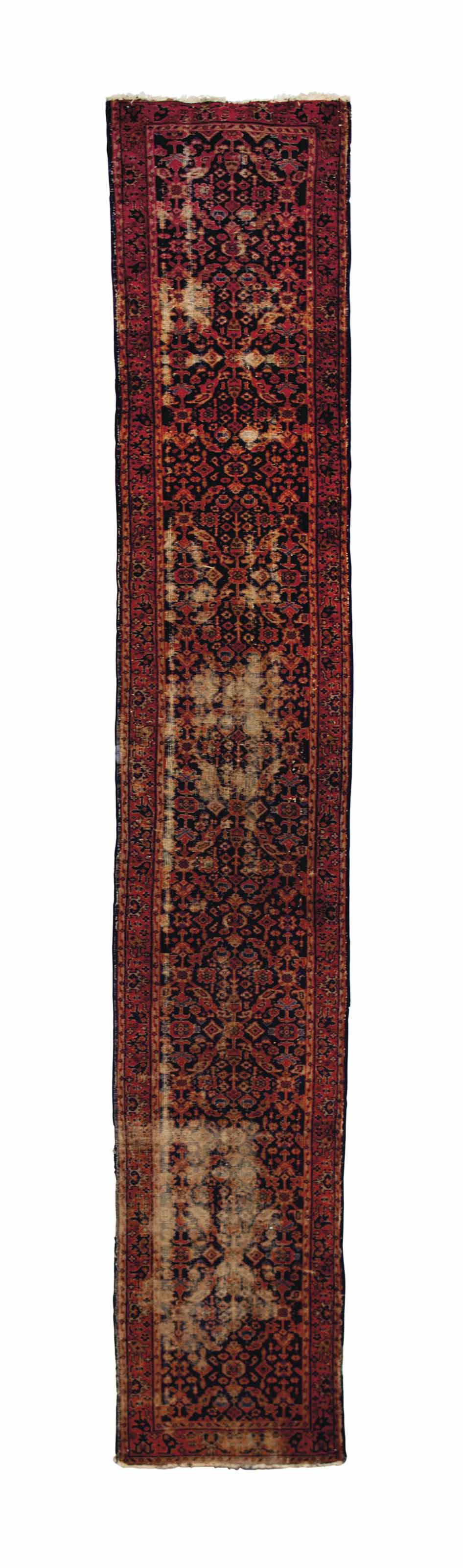 A MACHINE-MADE PERSIAN STYLE RUNNER,