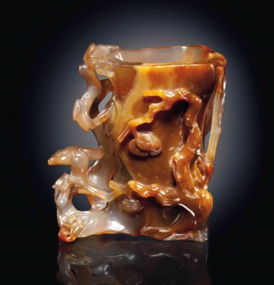 A MOTTLED BROWN AGATE 'THREE F