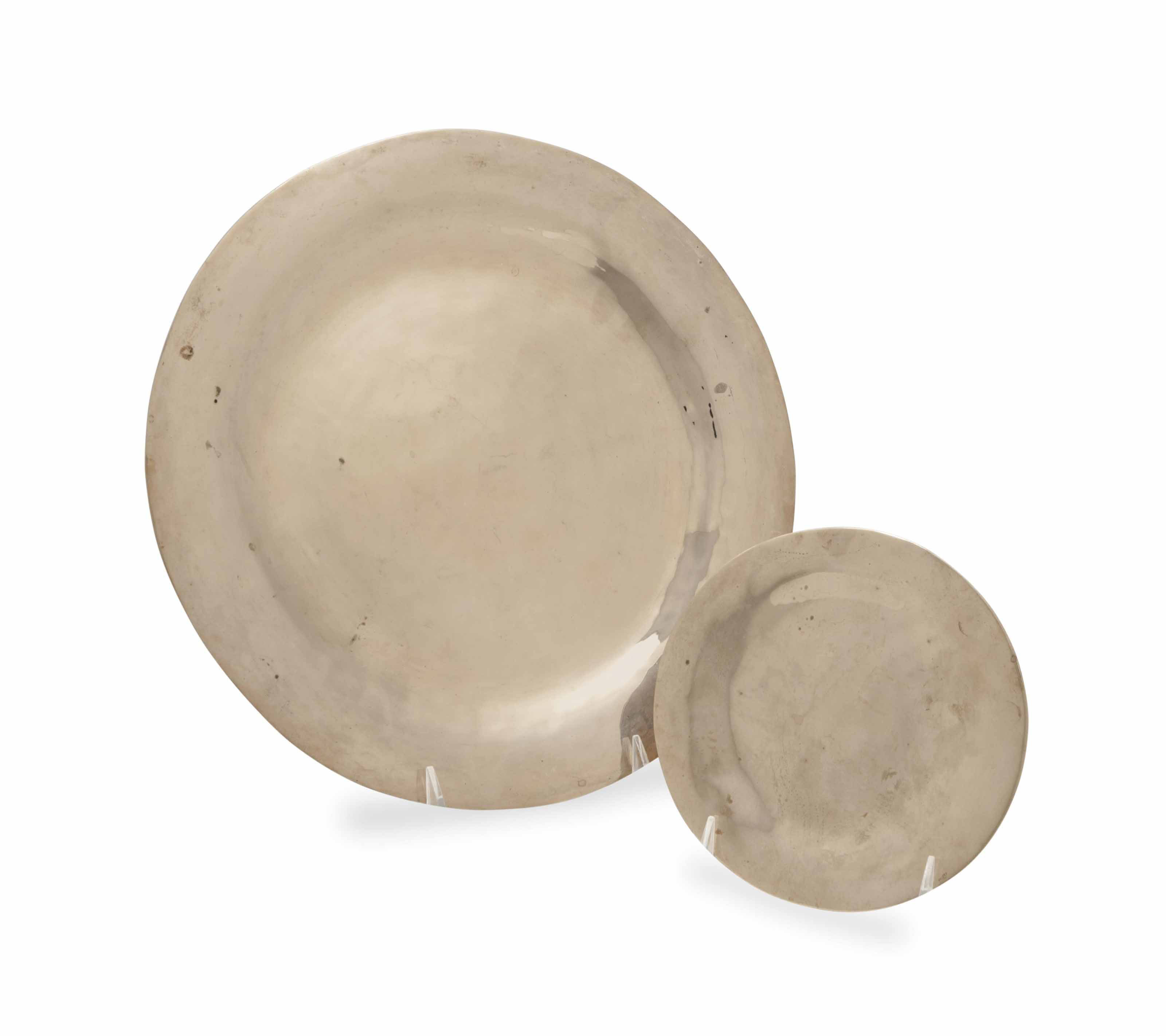 A SET OF HAMMERED METAL PLACE