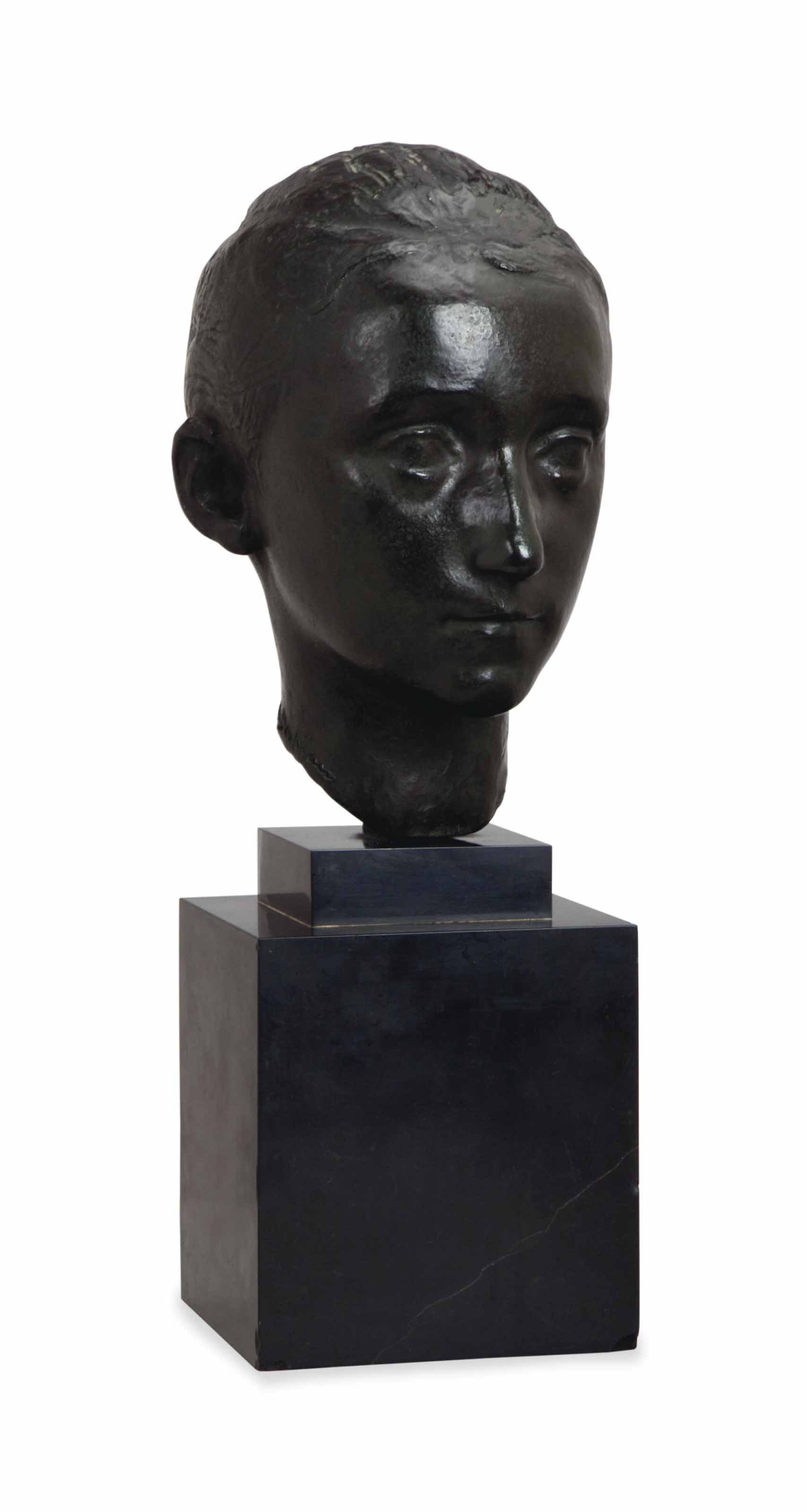 A BRONZE BUST OF A YOUNG WOMAN,