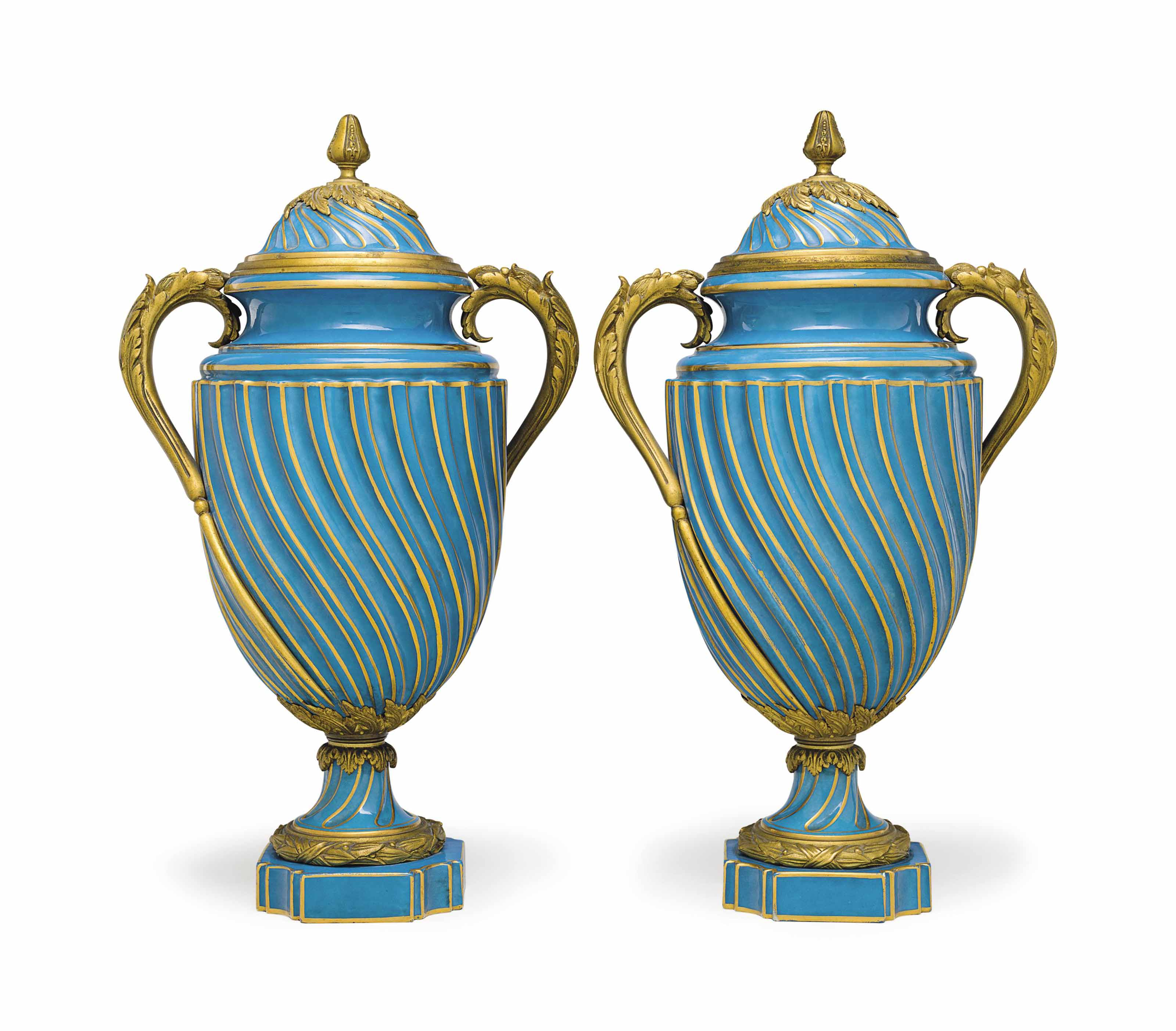 A PAIR OF ORMOLU-MOUNTED SEVRES STYLE PORCELAIN VASES AND