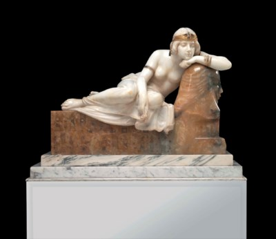 A WHITE MARBLE AND ONYX FIGURE