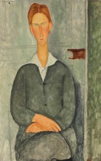 Jeune homme roux assis