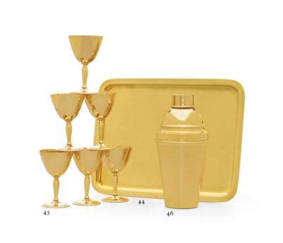A GOLD COCKTAIL SHAKER