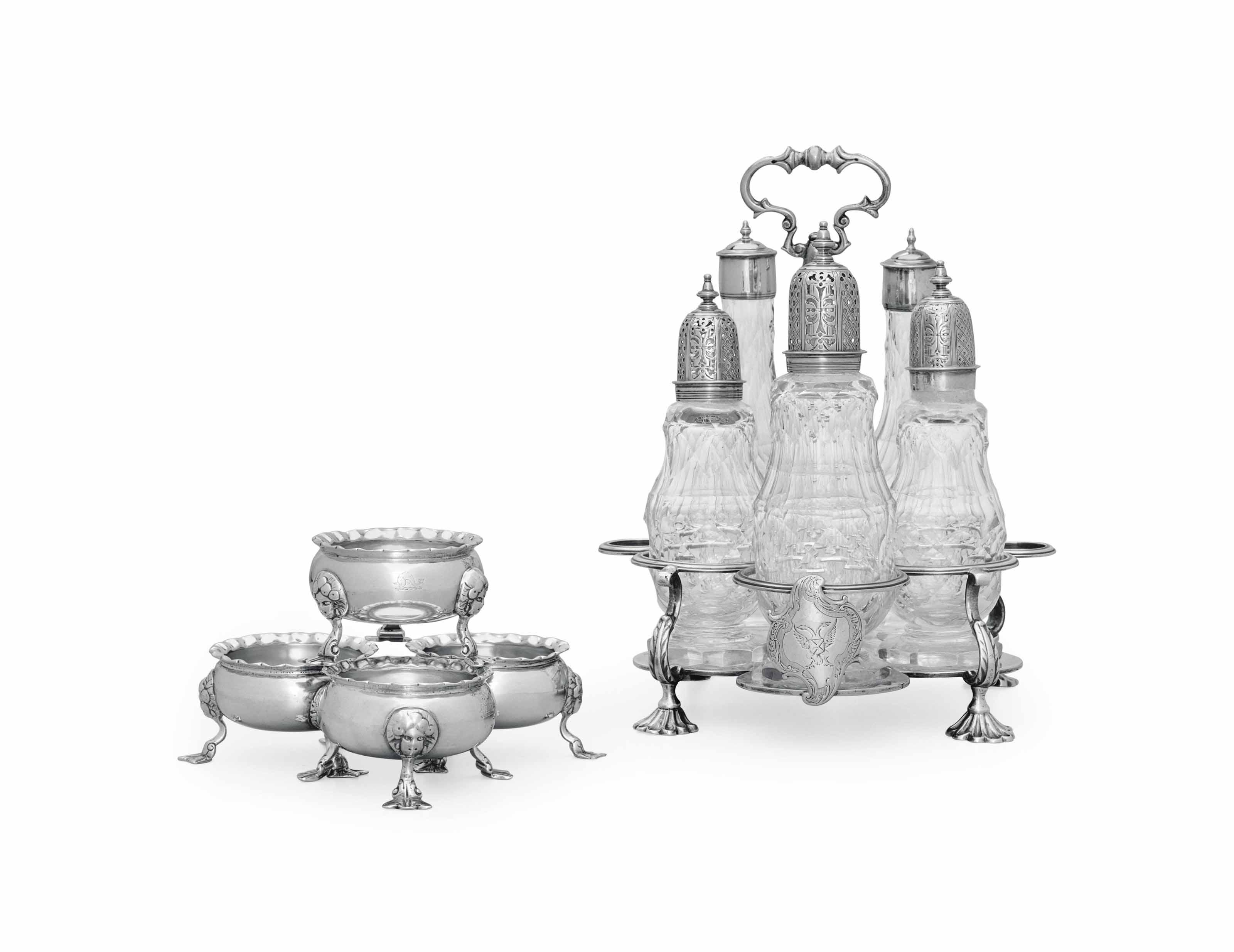 A GEORGE II SCOTTISH SILVER WARWICK CRUET AND A SET OF FOUR SILVER SALT CELLARS