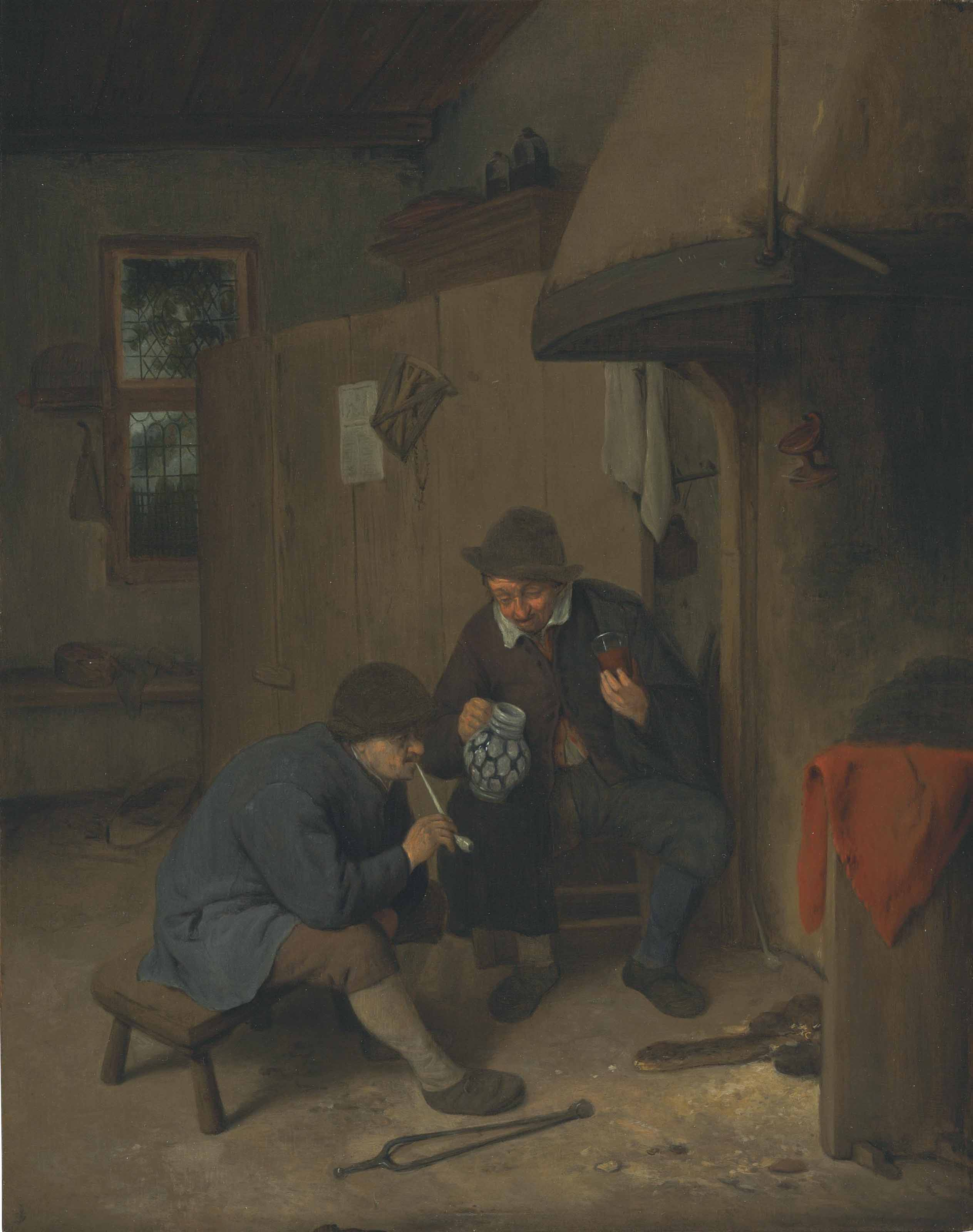 A kitchen interior with peasants drinking and smoking