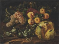 Grapes, apples, a melon and other fruit on a stone ledge