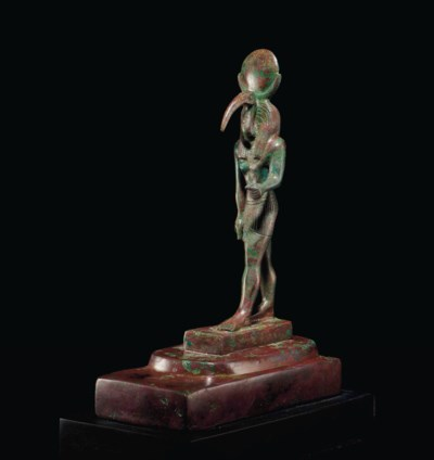 AN EGYPTIAN BRONZE THOTH