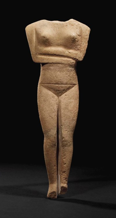 A CYCLADIC MARBLE RECLINING FE