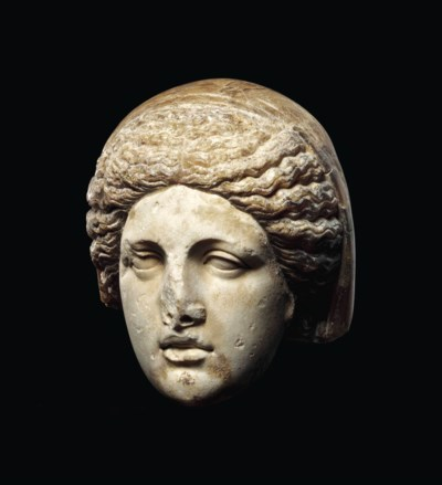 A GREEK MARBLE HEAD OF A GODDE