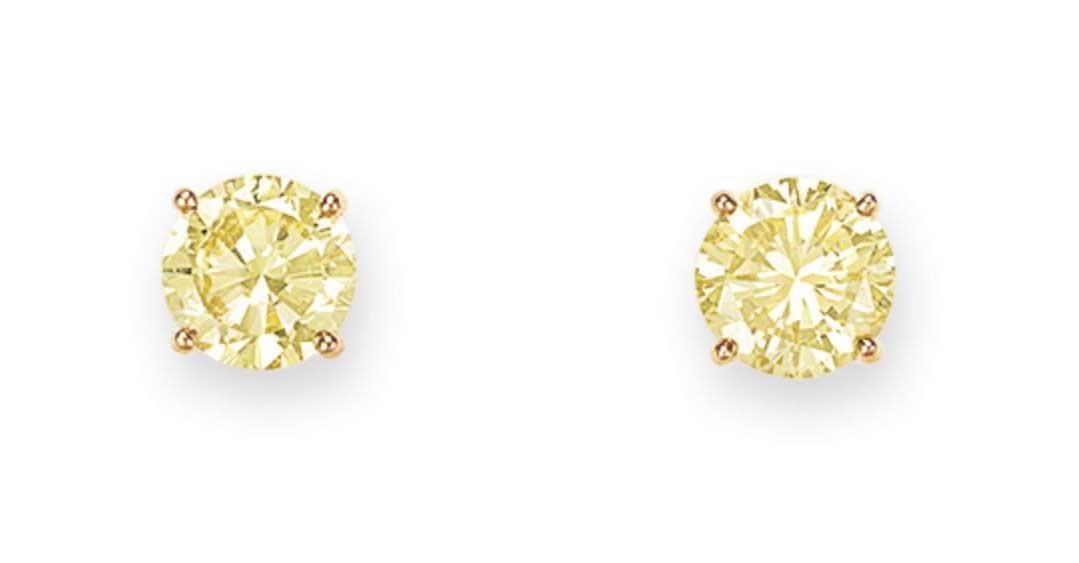 A PAIR OF COLORED DIAMOND EAR STUDS, BY TIFFANY & CO.