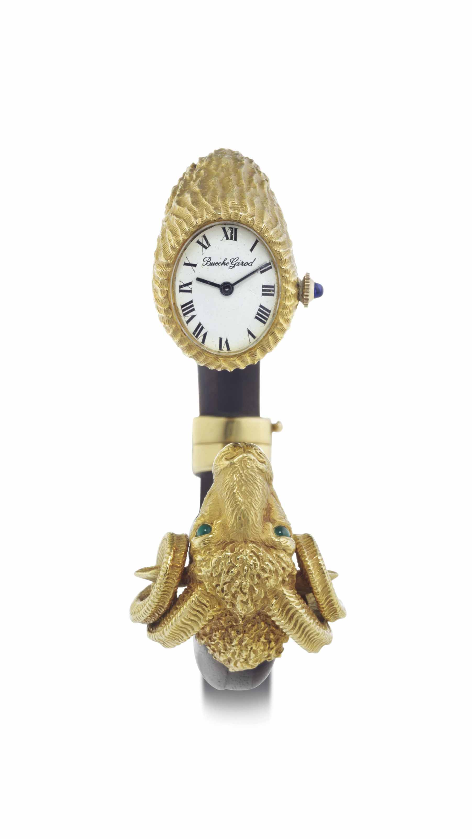 Bueche-Girod. A Lady's Fine 18k Gold, Emerald and Wood Ram's Head Bracelet Watch