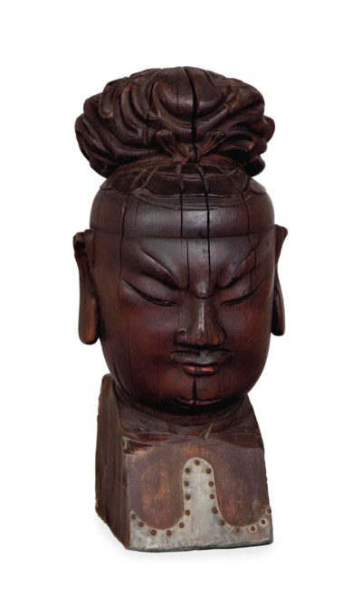 A CHINESE CARVED WOOD HEAD OF