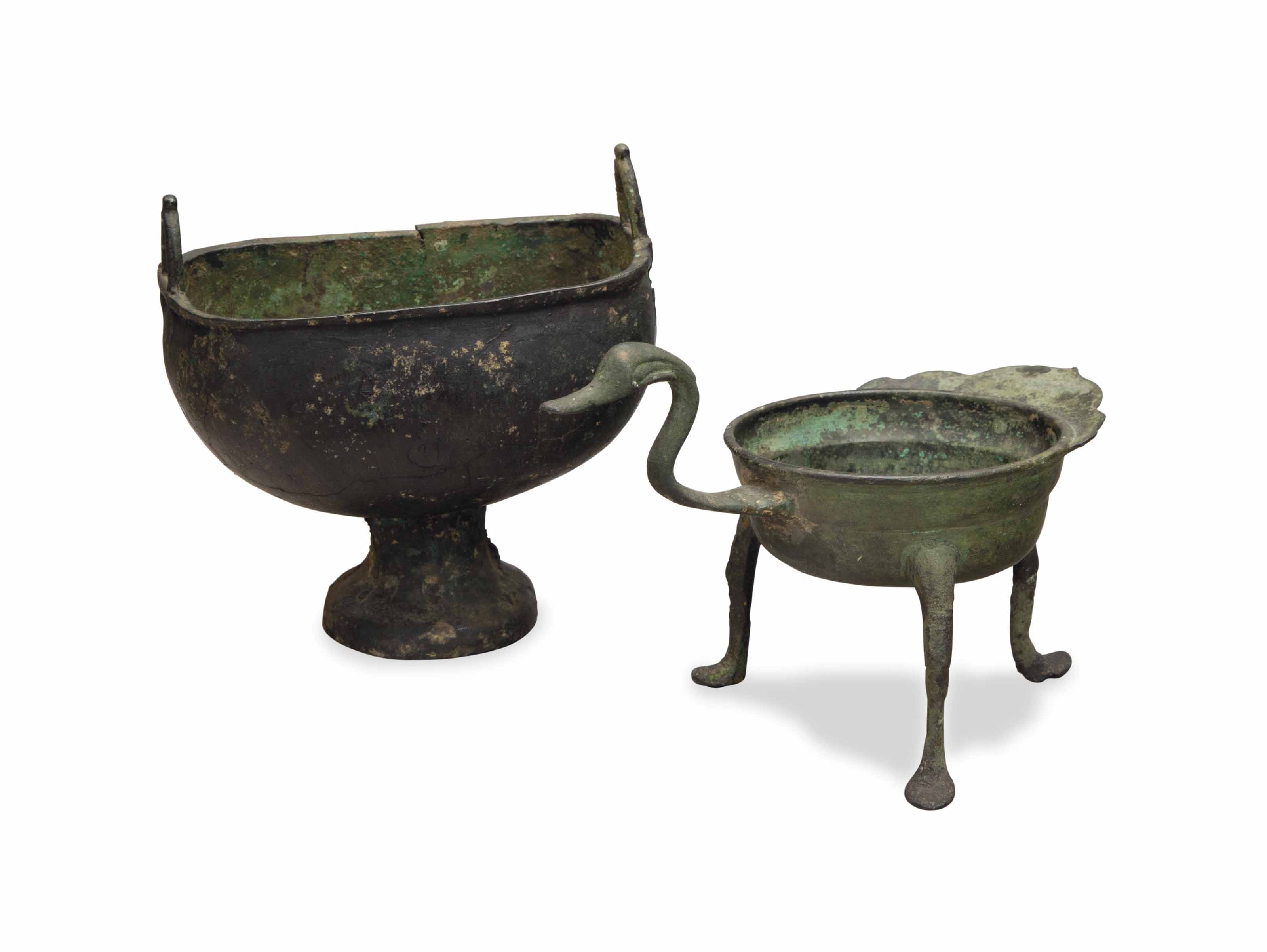 A CHINESE BRONZE FOOTED CAULDR