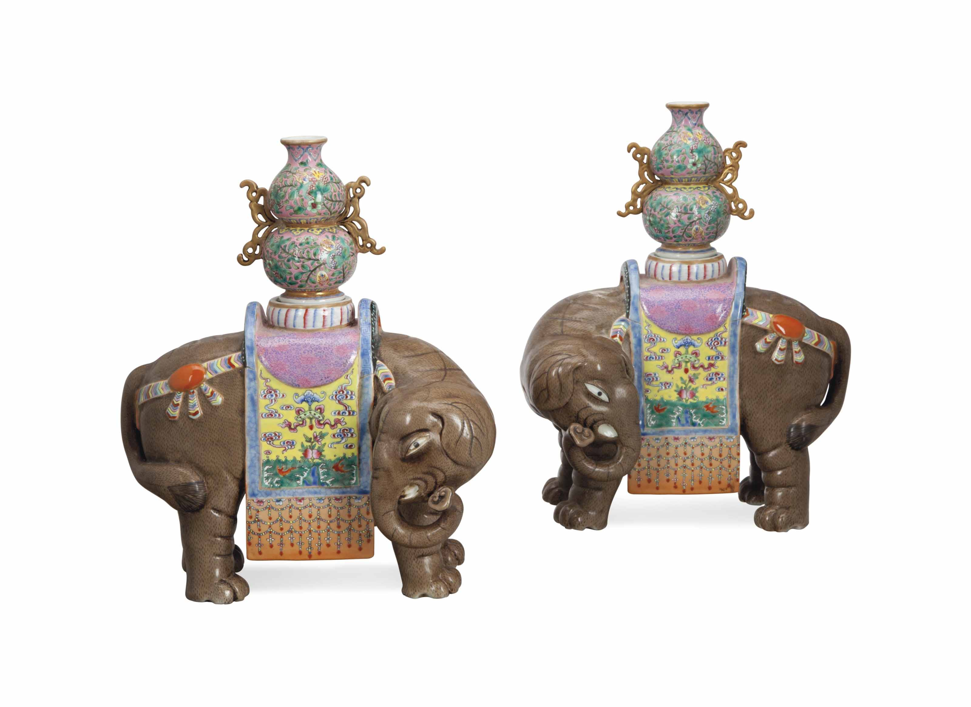A PAIR OF CHINESE FAMILLE ROSE PORCELAIN ELEPHANTS SUPPORTING VASES