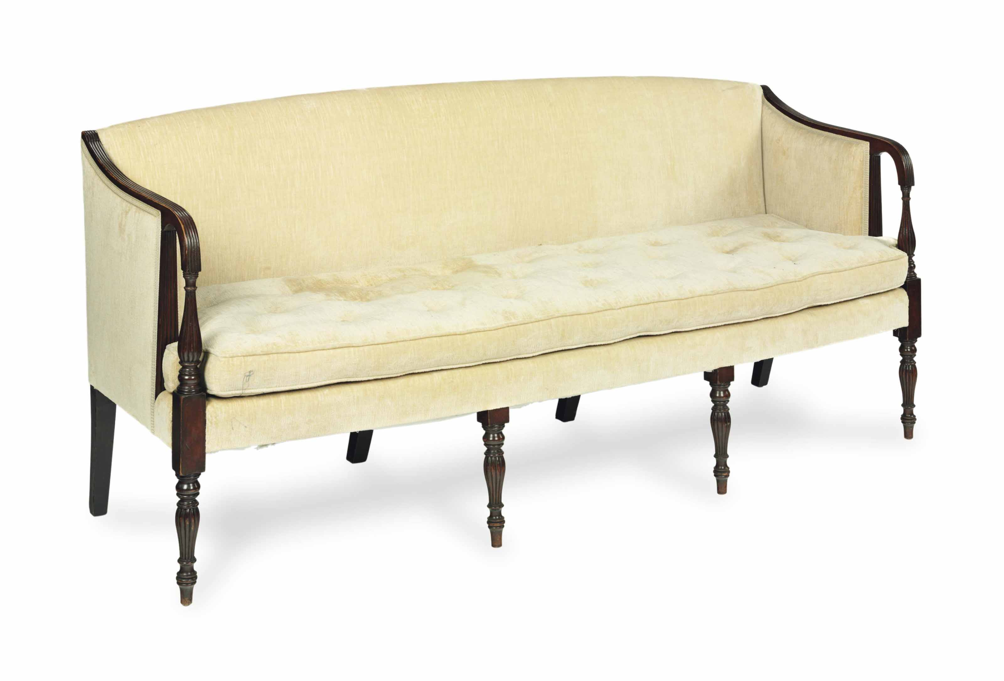 A MAHOGANY SOFA COVERED IN BEI