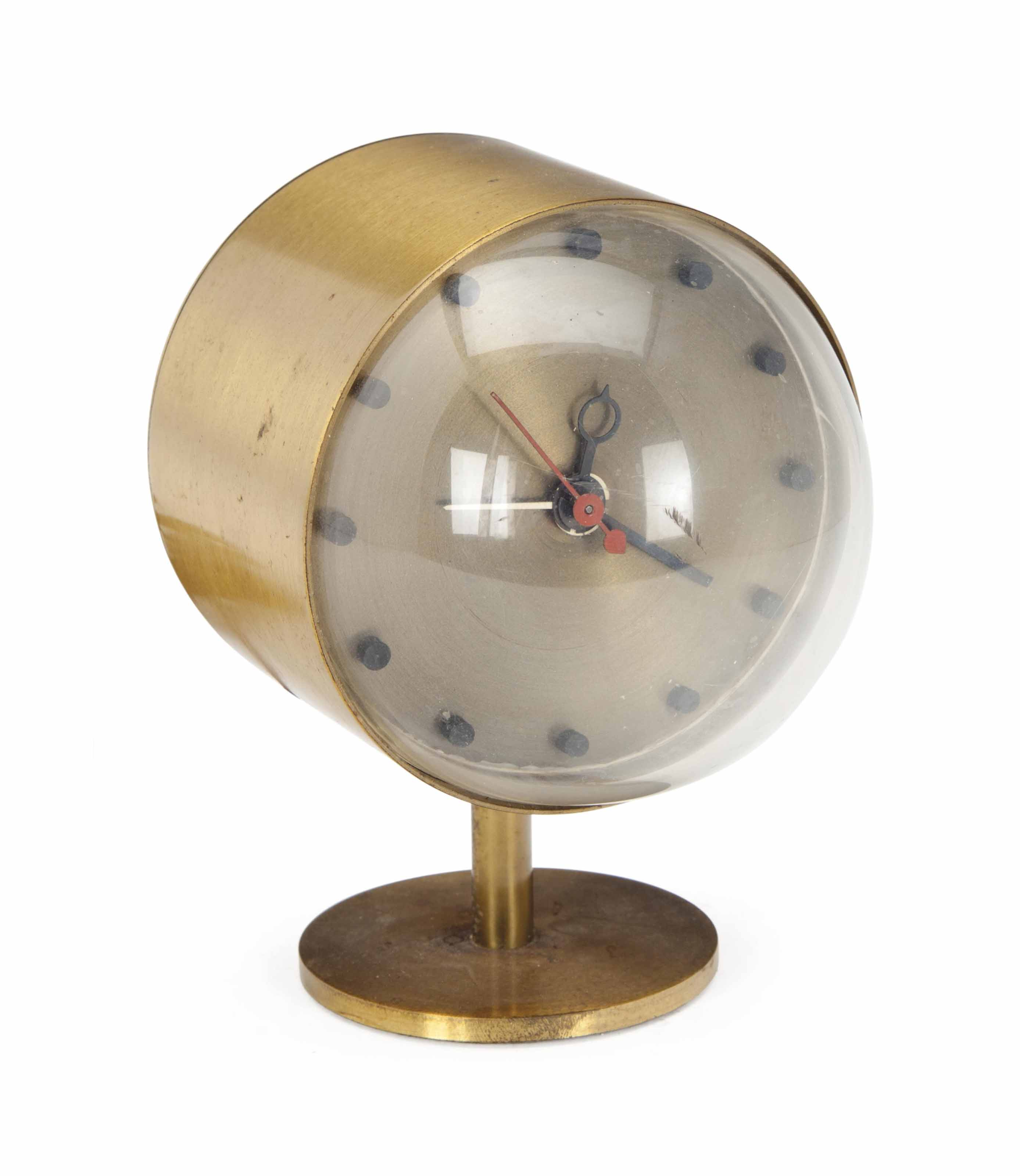 A BRASS TABLE CLOCK,