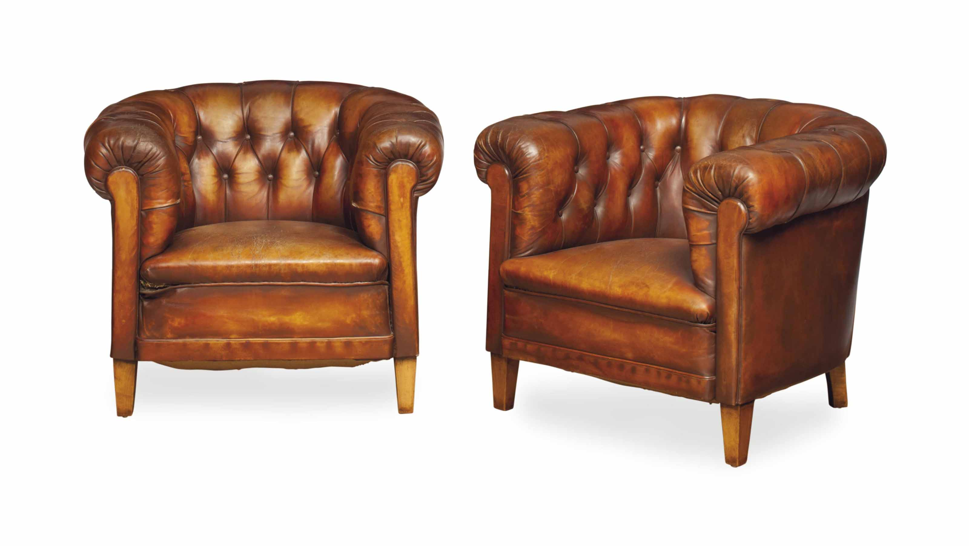 A PAIR OF BUTTON-TUFTED LEATHE