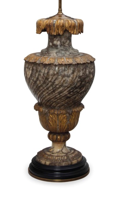 A MARBLE AND PARCEL GILT TABLE