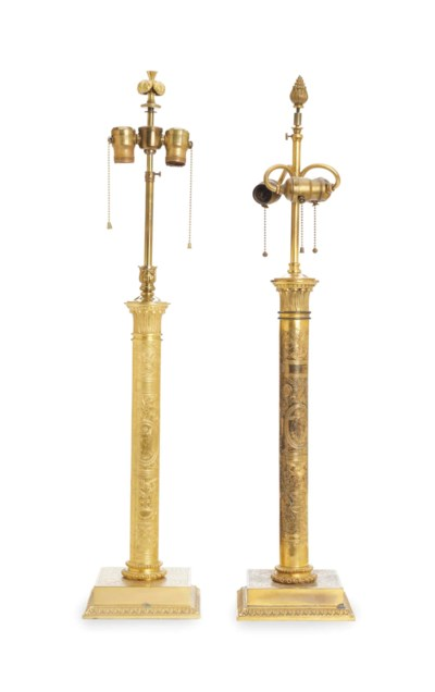 A SET OF TWO GILT METAL LAMPS,
