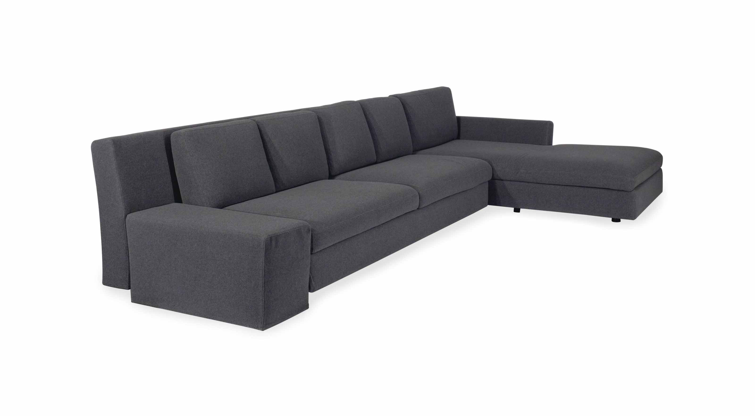 A GREY-UPHOLSTERED SECTIONAL S