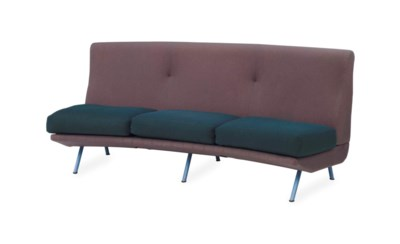 AN UPHOLSTERED AND ENAMELED ME