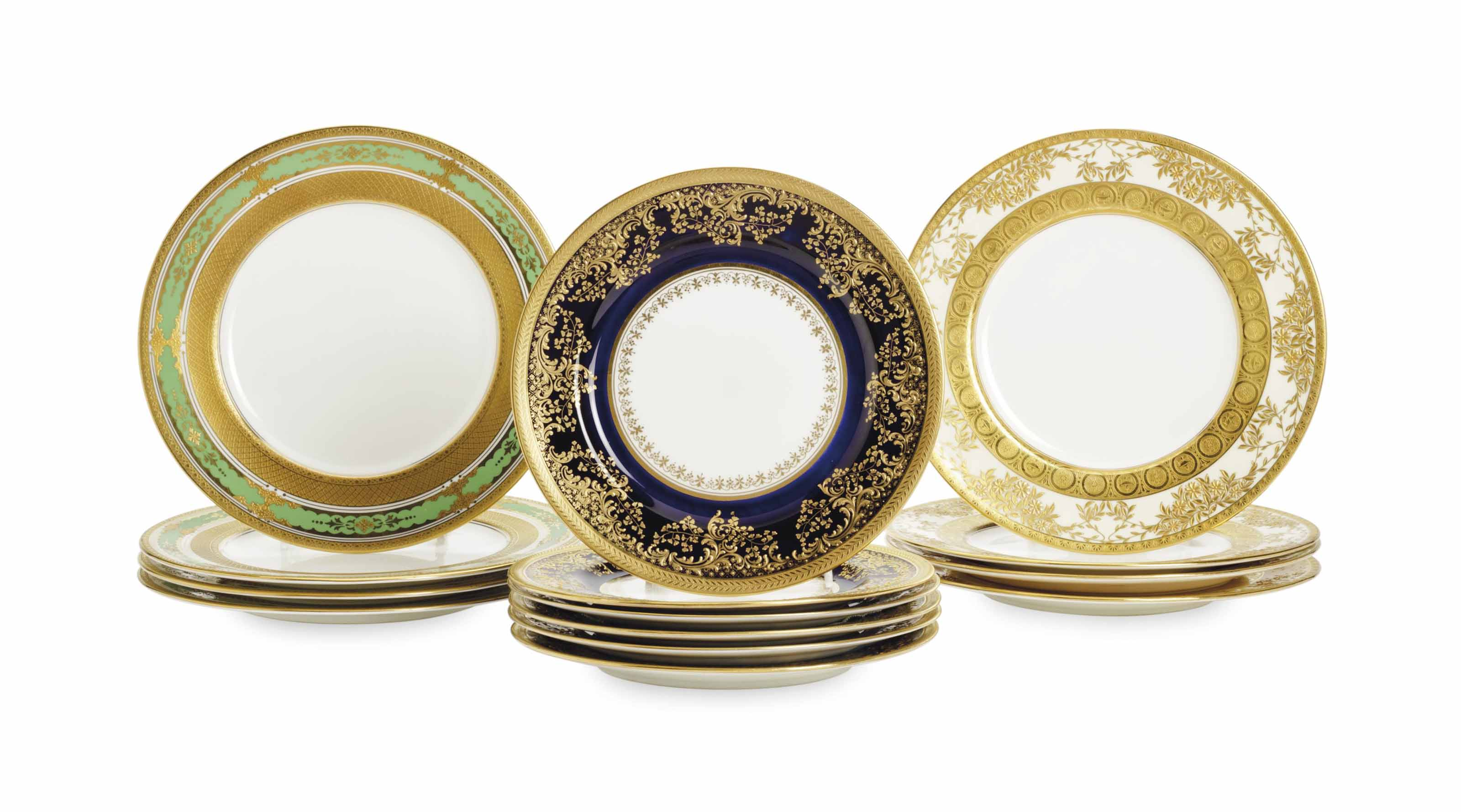 THREE SETS OF ENGLISH GILT DECORATED PLATES,